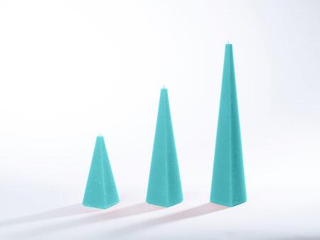 Pyramidenkerzen türkis
